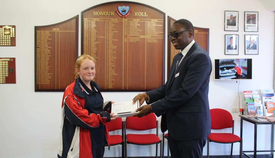 Winner of the 2021 Payment Incentive draw Annabelle Lydeamore with Deputy Principal Mr Innocent Chikwama